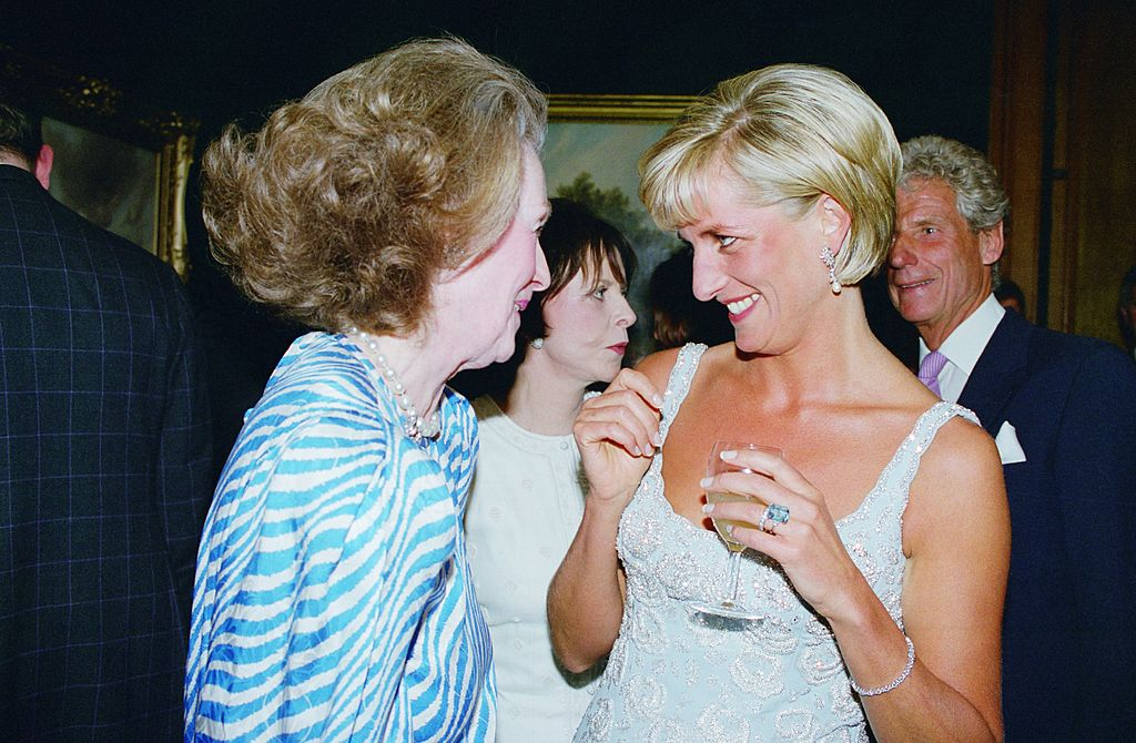 Diana, Princess of Wales at a private viewing and reception at Christies in aid of the Aid Crisis Trust and The Royal Marsden Hospital Cancer Fund, Diana is with her step-mother Raine, Comtesse De Chambrun (formerly Countess Raine Spencer), Diana is wearing a dress by Catherine Walker