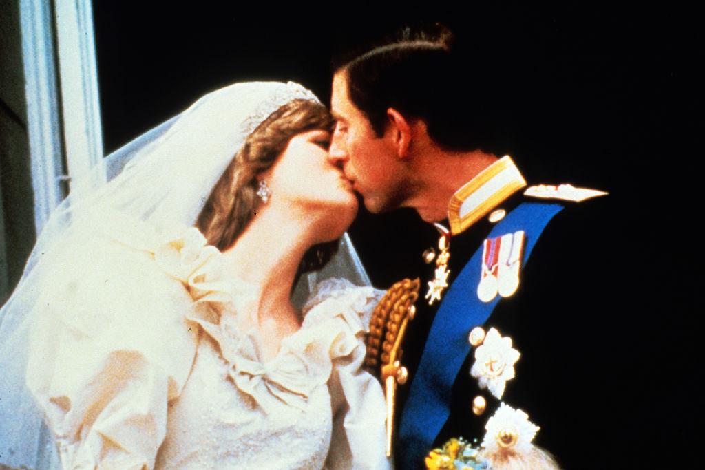 Princess Diana and Prince Charles kissing on  balcony