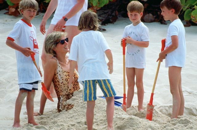 Princess Diana gets buried in sand by her sons, Prince Harry and Prince William, while on vacation