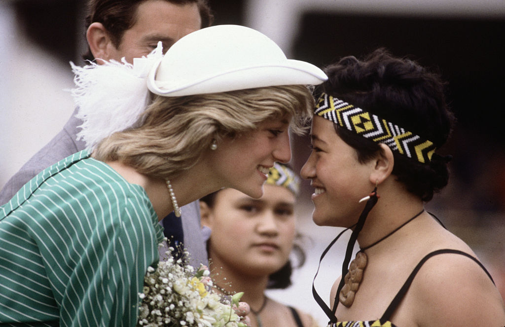 Princess Diana is greeted with the traditional greeting of a nose rub upon her arrival in Auckland, New Zealand