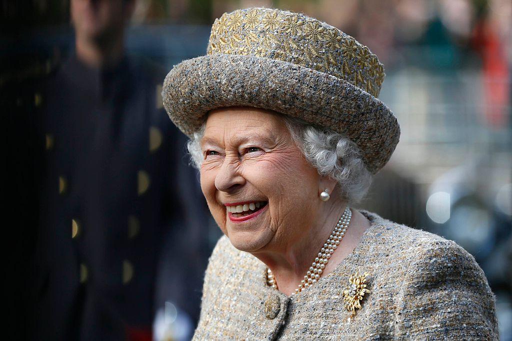 Queen Elizabeth II smiling, looking away from the camera