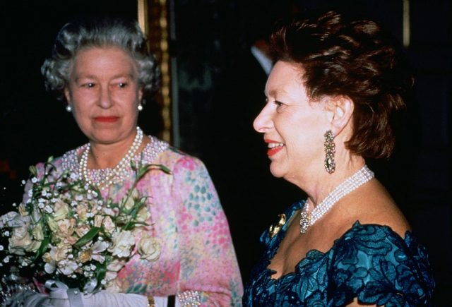 Queen Elizabeth II and Princess Margaret attend a charity concert