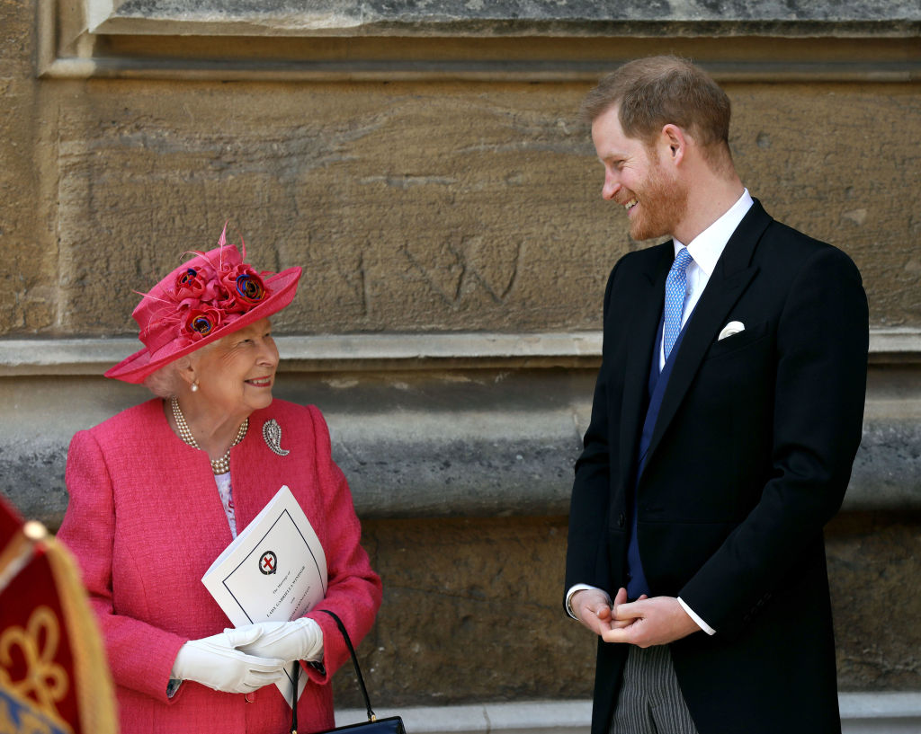 Queen Elizabeth II speaks with Prince Harry, Duke of Sussex as they leave after the wedding of Lady Gabriella Windsor to Thomas Kingston