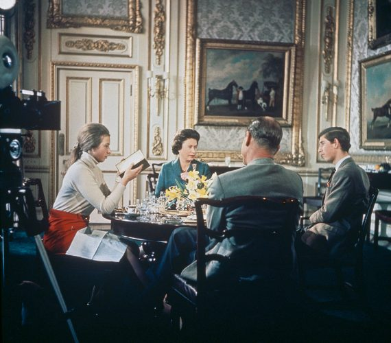 Queen Elizabeth II and Prince Philip having lunch with two of their children, Prince Charles and Princess Anne