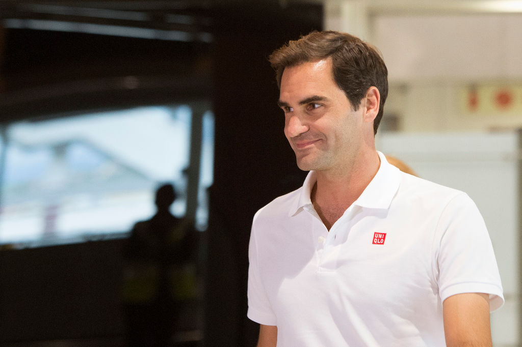 Roger Federer smiling, looking off camera