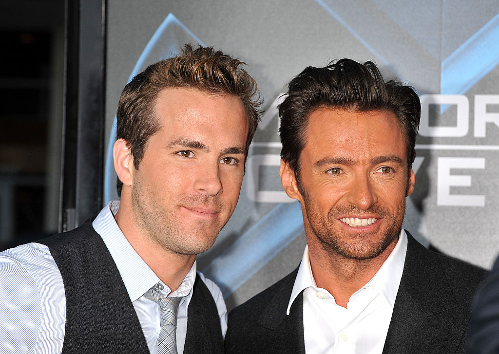 Ryan Reynolds and Hugh Jackman smiling