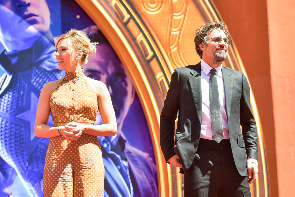 Scarlett Johansson and Mark Ruffalo smiling and looking off camera in the opposite direction