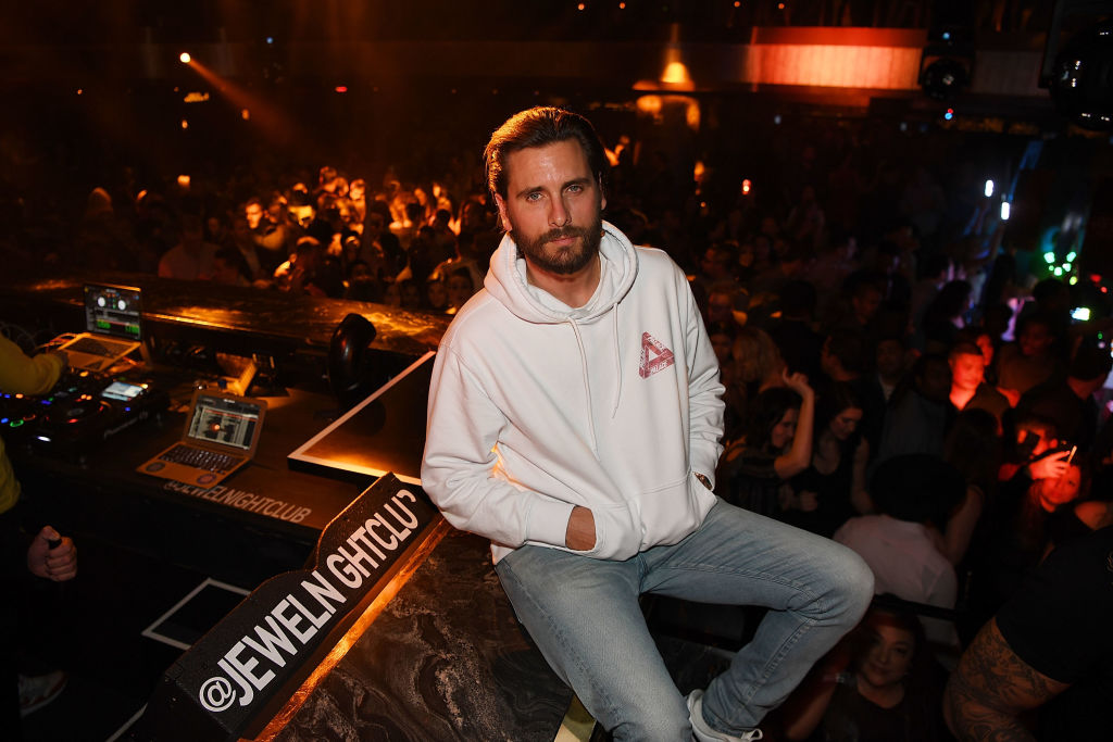 Scott Disick sitting down with his hands in his pockets