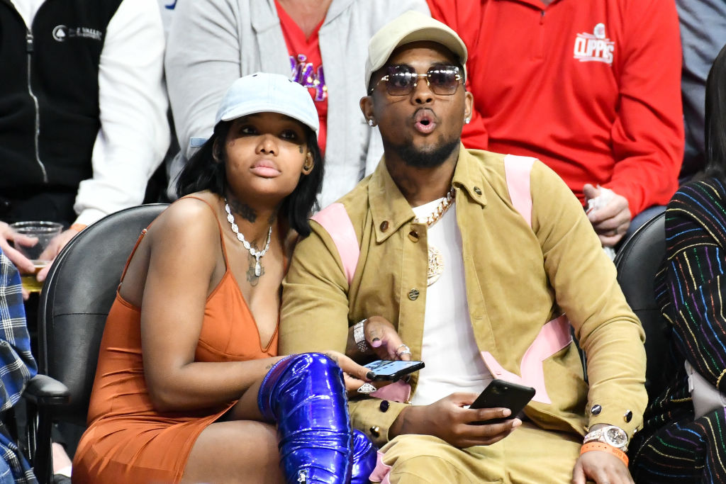 Summer Walker and London On Da Track at a basketball game in March 2020 in Los Angeles, California