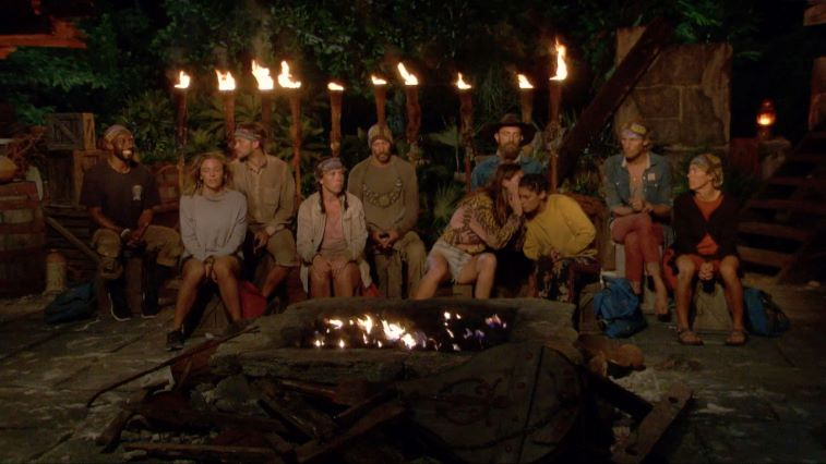 Castaways whispering at tribal council