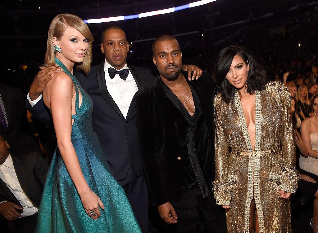 Taylor Swift, Jay-Z, Kanye West, Kim Kardashian West smiling at the camera in semi formal dress