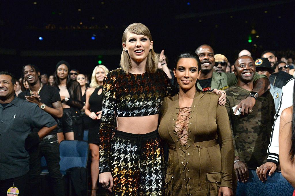 Taylor Swift with her arm around Kim Kardashian West