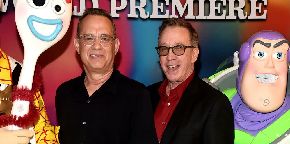Tom Hanks and Tim Allen on the red carpet at a movie premiere in June 2019