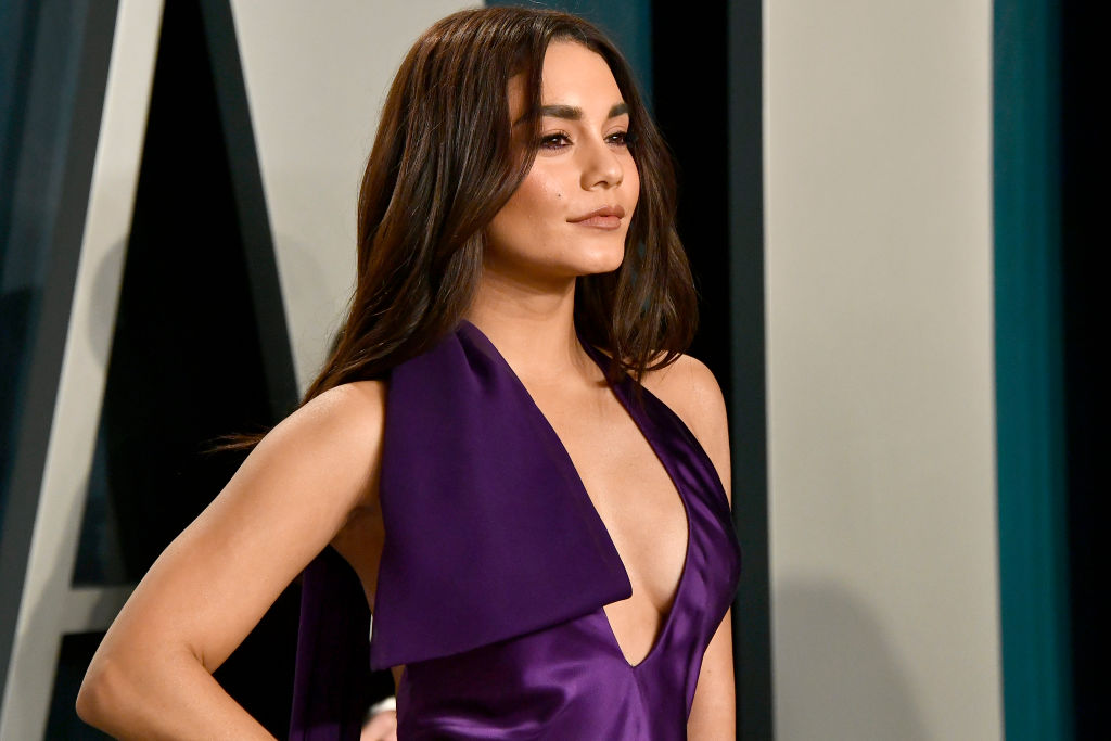 Vanessa Hudgens smiling, head tilted off camera, in a royal purple dress