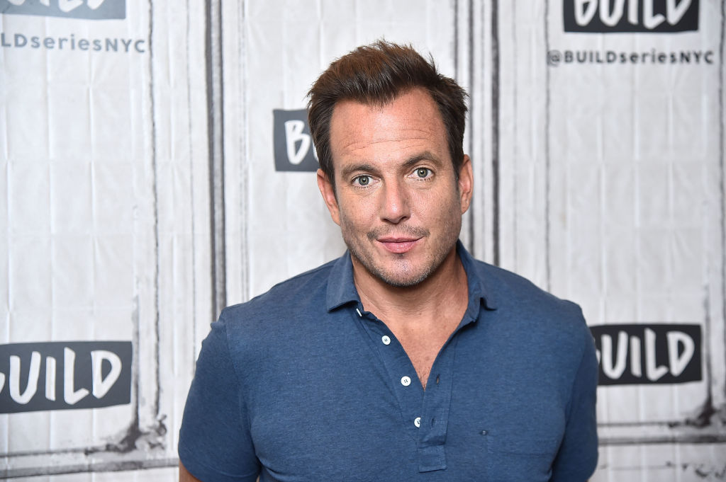 Will Arnett smiling in front of a repeating background