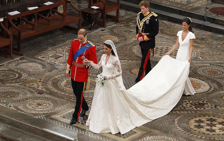Pippa Middleton holds Kate Middleton's dress at the royal wedding in 2011