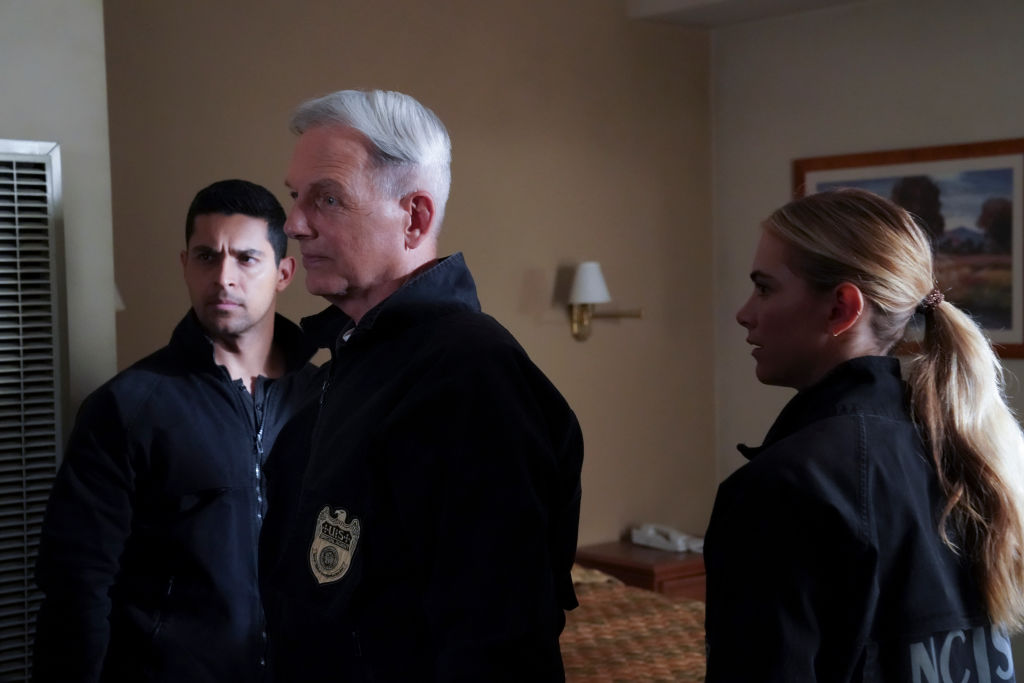 """Wilmer Valderrama as NCIS Special Agent Nicholas """"Nick"""" Torres, Mark Harmon as NCIS Special Agent Leroy Jethro Gibbs, and Emily Wickersham as NCIS Special Agent Eleanor """"Ellie"""" Bishop. 