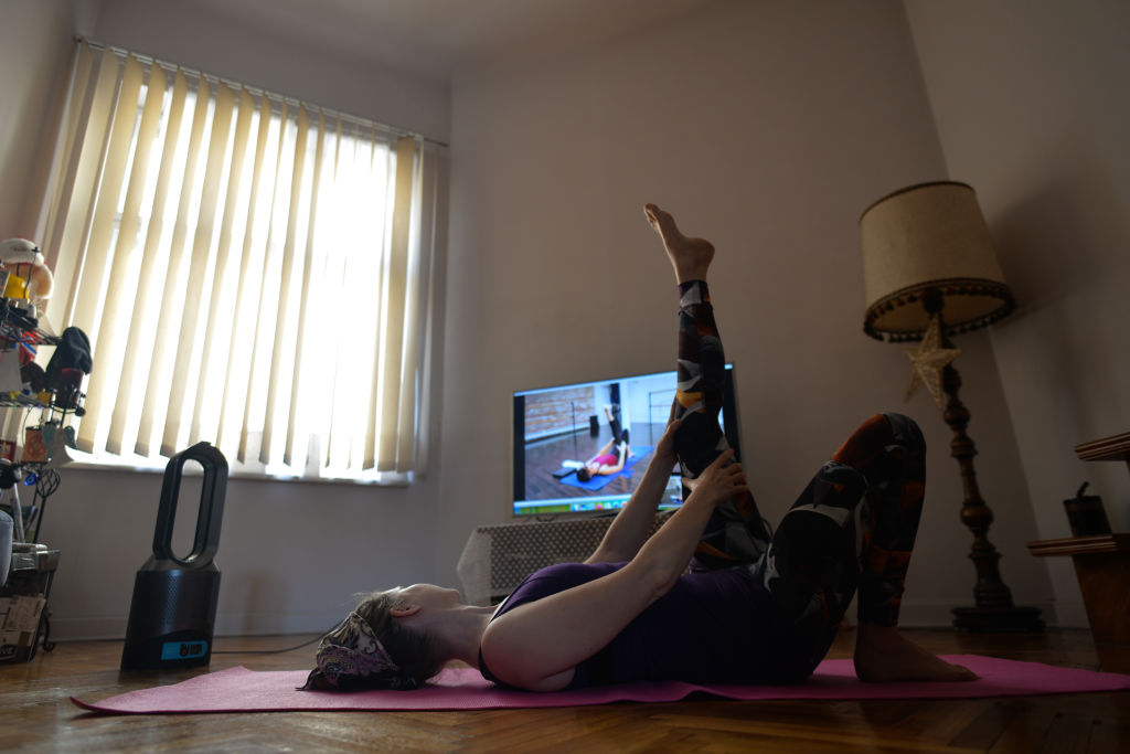 Woman exercising at home in Krakow