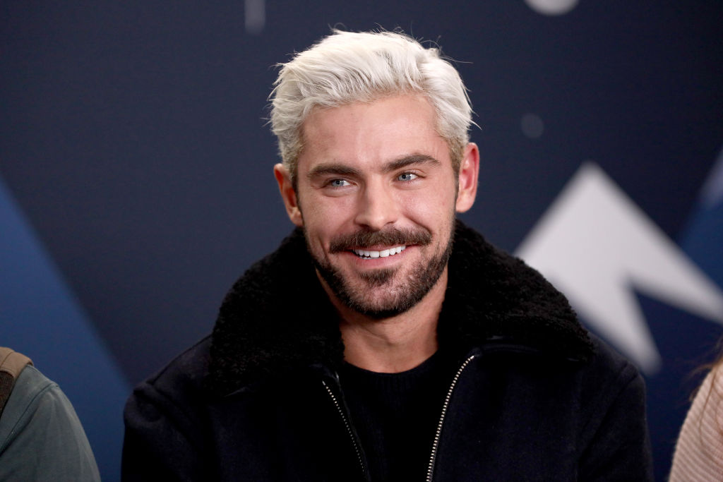 Zac Efron smiling looking off camera