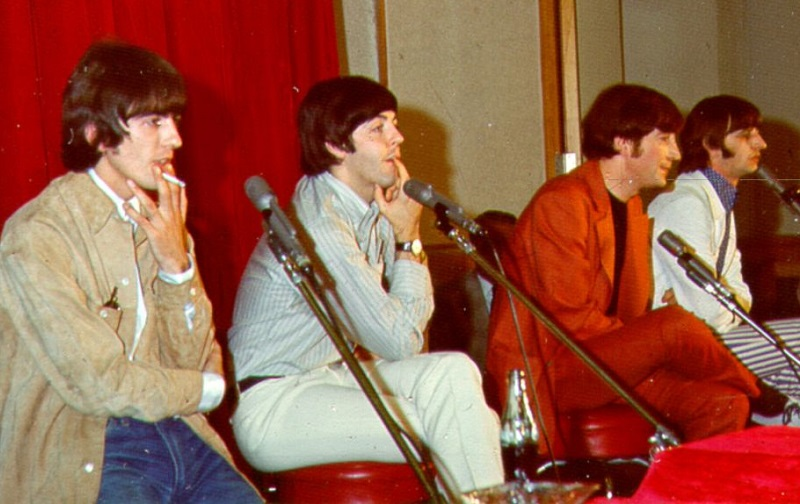 The Beatles sit talking to the press
