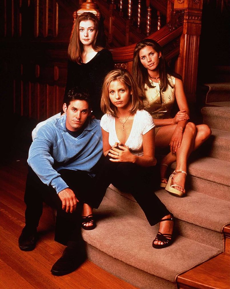 "Alyson Hannigan as Willow Rosenberg, Charisma Carpenter as Cordelia Chase, Sarah Michelle Gellar as Buffy and Nicholas Brendon as Xander Harris in ""Buffy The Vampire Slayer.'"