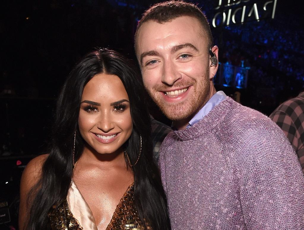 Demi Lovato (L) and Sam Smith attend 102.7 KIIS FM's Jingle Ball 2017