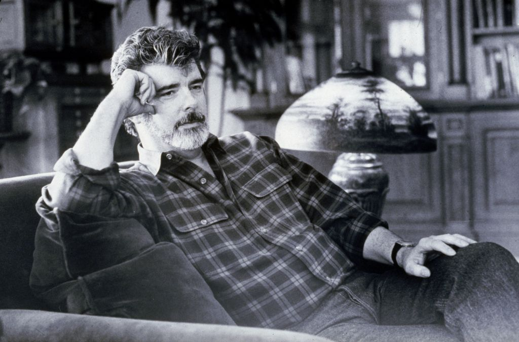 Star Wars creator George Lucas sitting by a lamp
