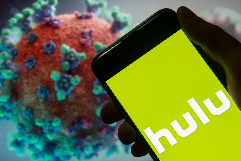 Hulu logo on a smart phone in front of coronavirus