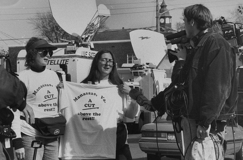 People sell t-shirts during John Bobbitt's trial