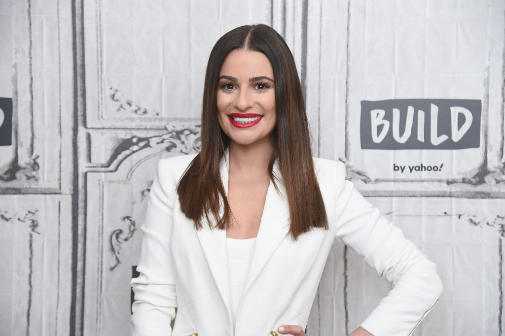 Lea Michele smiles on the red carpet for her appearance on the Build Series to discuss her holiday projects.