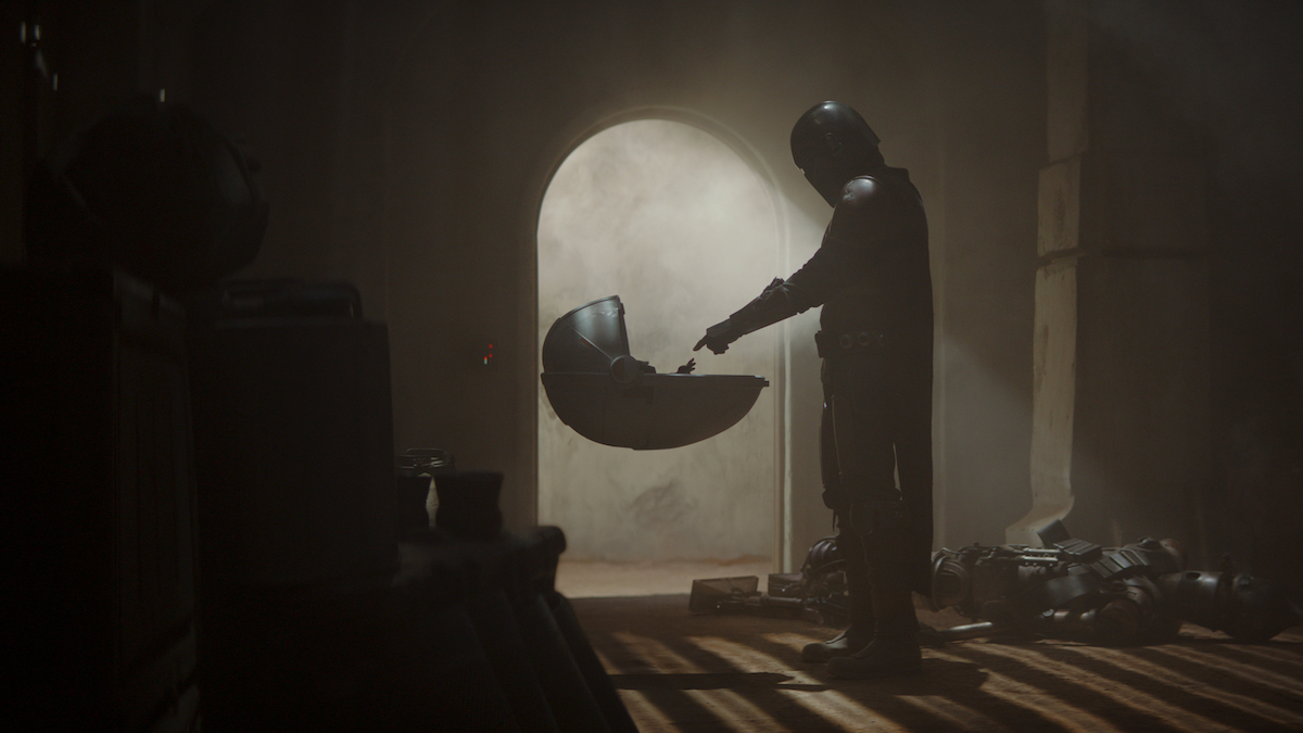 The Mandalorian with The Child in the first episode of, 'They Mandalorian.'
