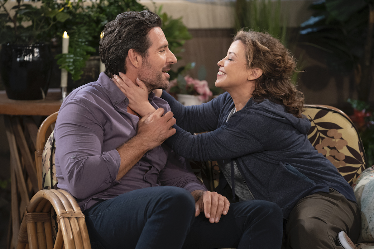 Max (Ed Quinn) and Penelope (Justina Machado) kiss on the rooftop in 'ONE DAY AT A TIME'