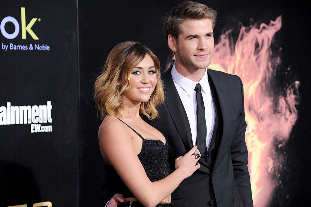 Miley Cyrus and Liam Hemsworth attend 'The Hunger Games' Los Angeles Premiere on March 12, 2012