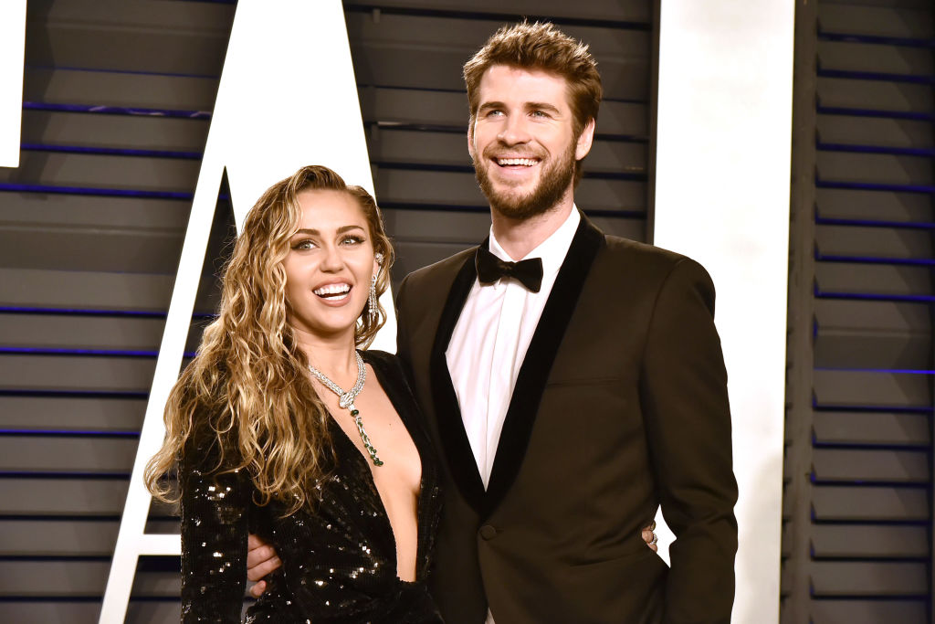 Liam Hemsworth and Miley Cyrus attend the Vanity Fair Oscar Party on February 24, 2019
