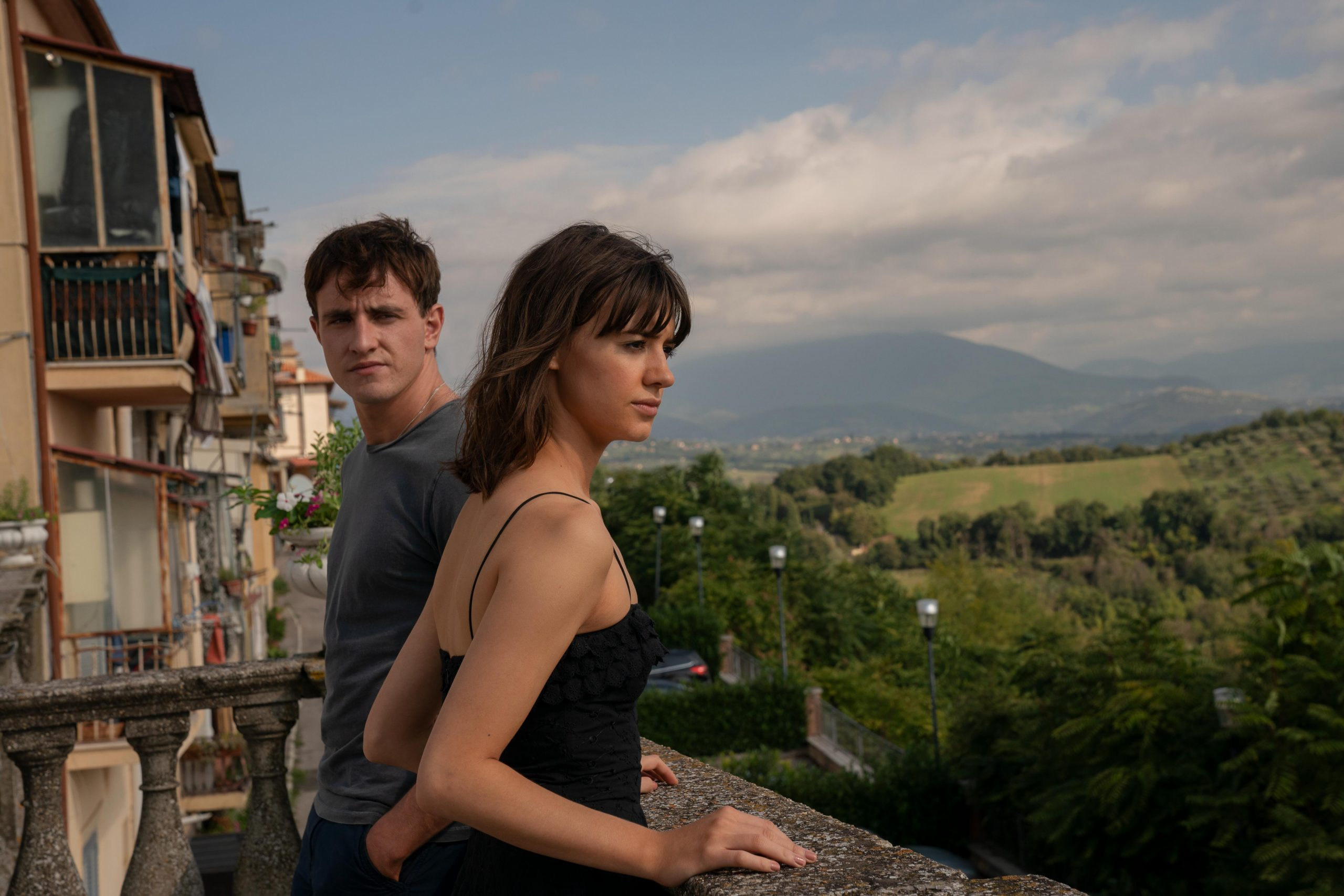 Connell and Marianne standing on a balcony in an episode of Normal People