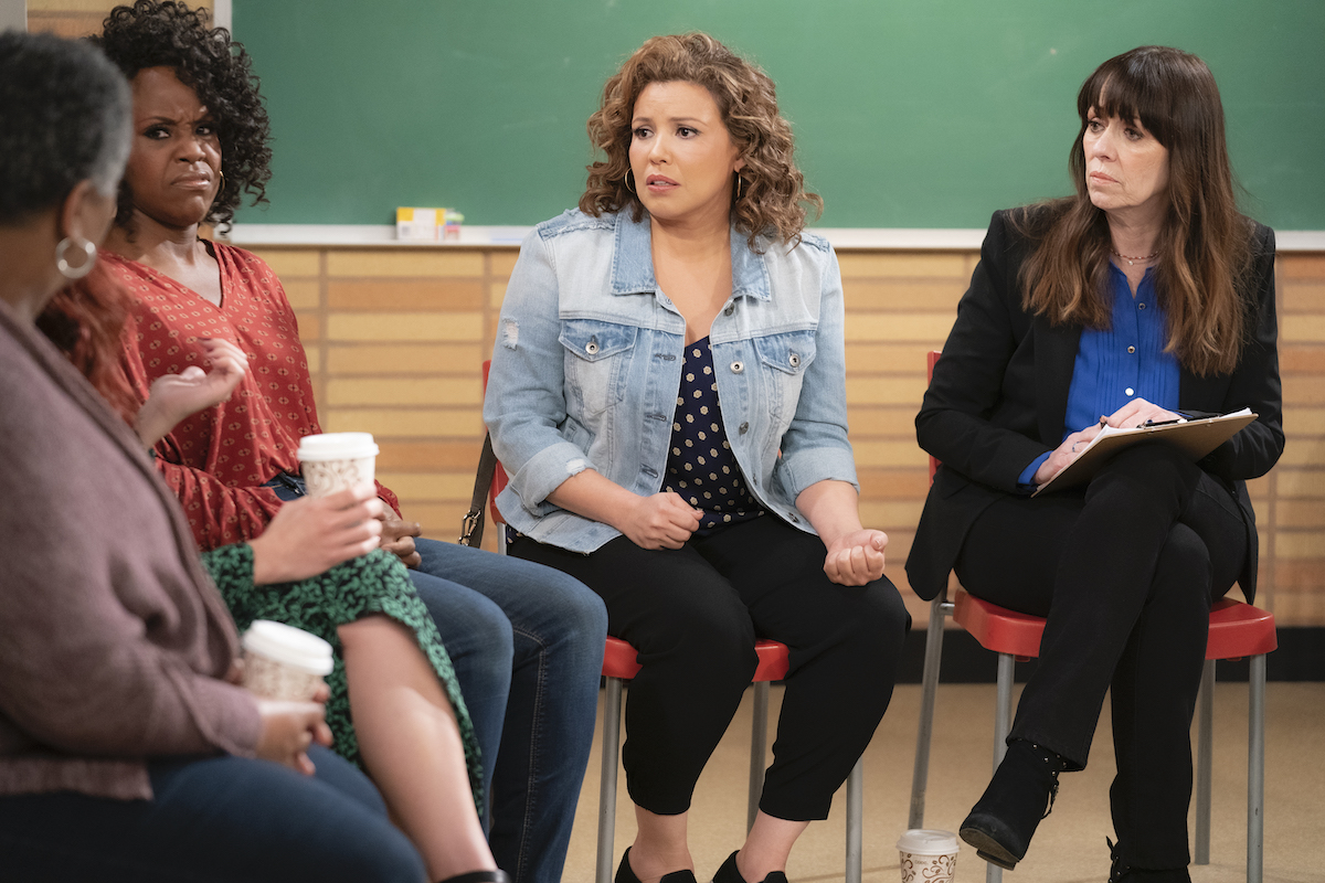 Penelope in her group therapy session, 'One Day at a Time.'