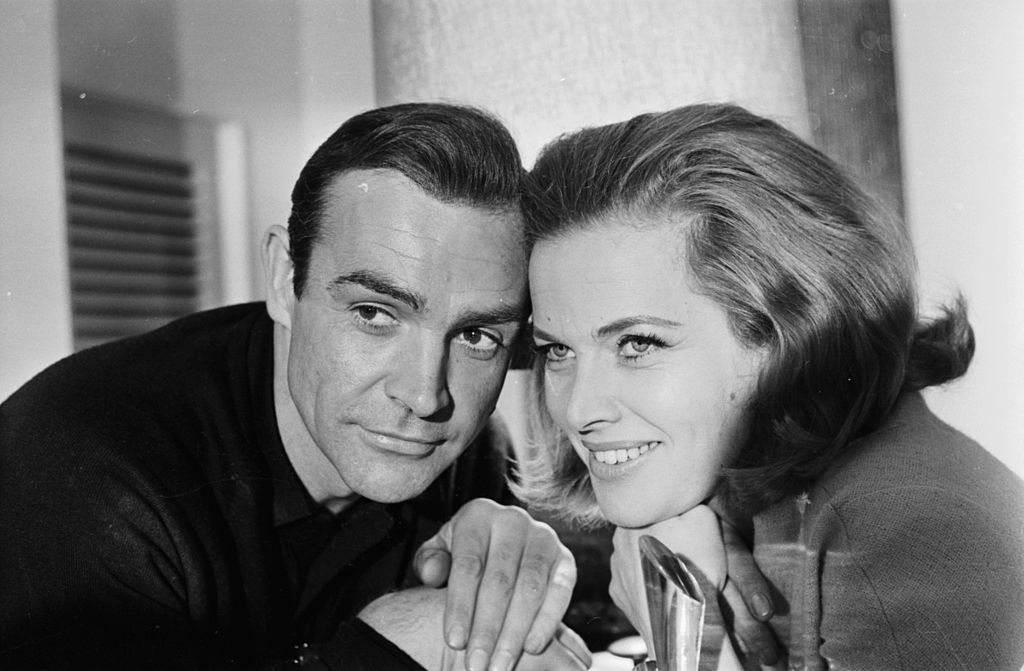 Pussy Galore (played by Honor Blackman) with James Bond 007 (played by Sean Connery)