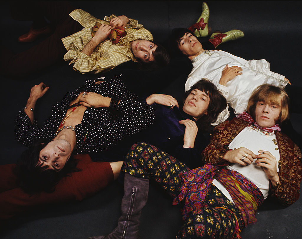 The Rolling Stones lying on the floor