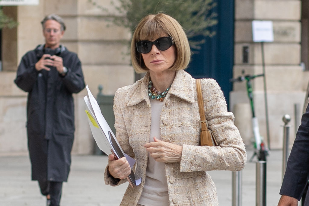 Anna Wintour wearing sunglasses and an oatmeal colored blazer