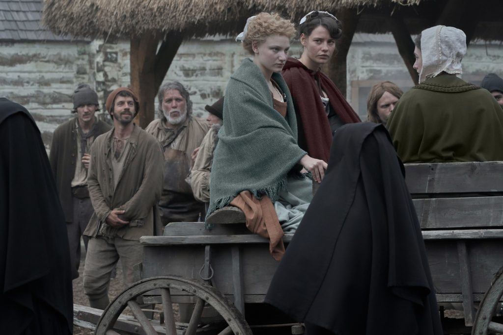Melissande (Tallulah Haddon), Delphine (Lily Sullivan), and the other Filles Du Roi arrive in Wobik.