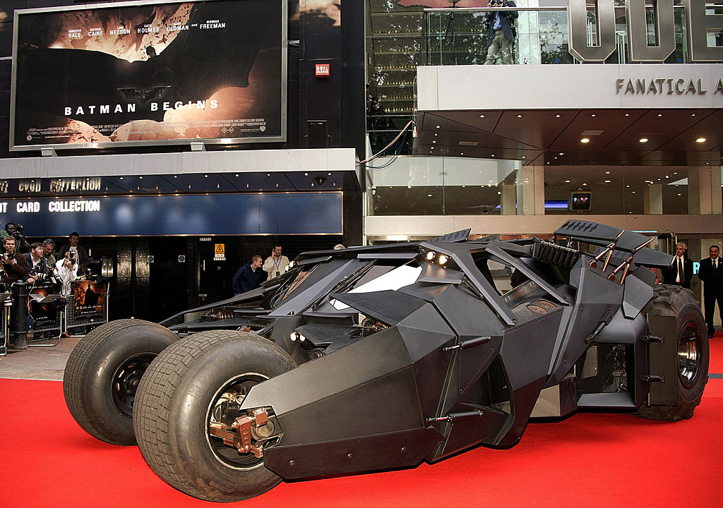 The Batmobile sitting on the red carpet