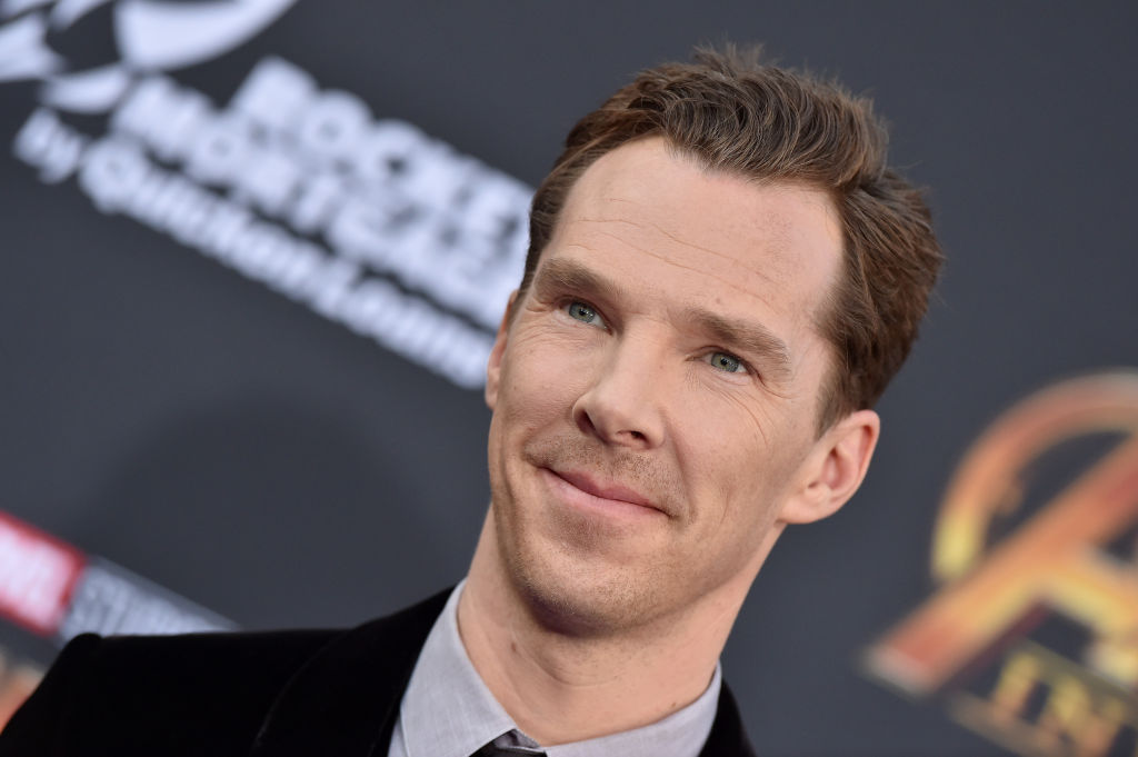 Benedict Cumberbatch smiling looking away from the camera