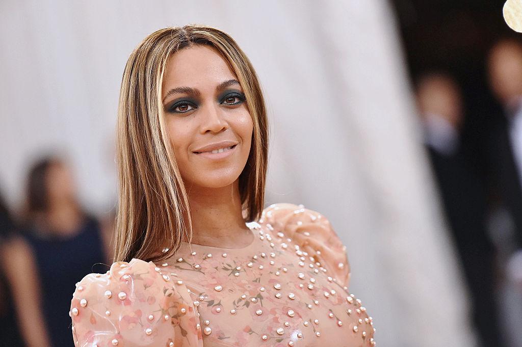 Beyoncé smiling looking past the camera