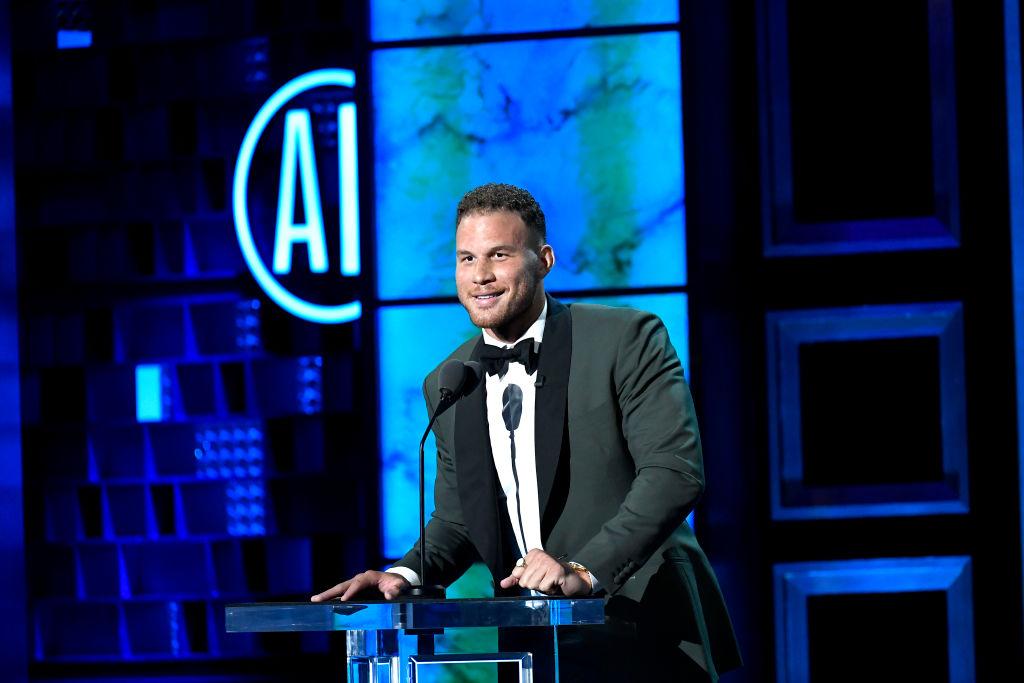 Blake Griffin smiling at a podium