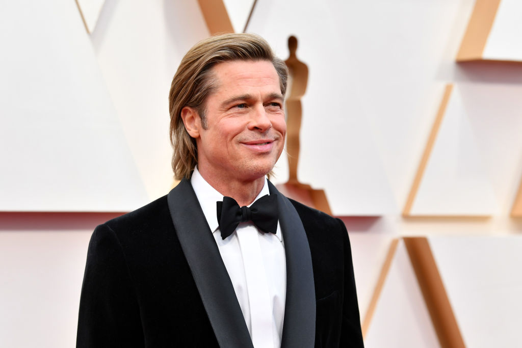Brad Pitt smiling, turned slightly to the side