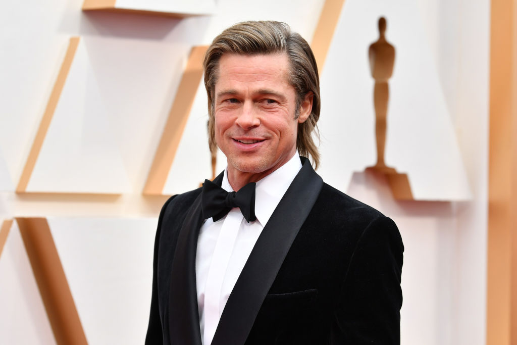 Brad Pitt smiling, turned slightly to the side