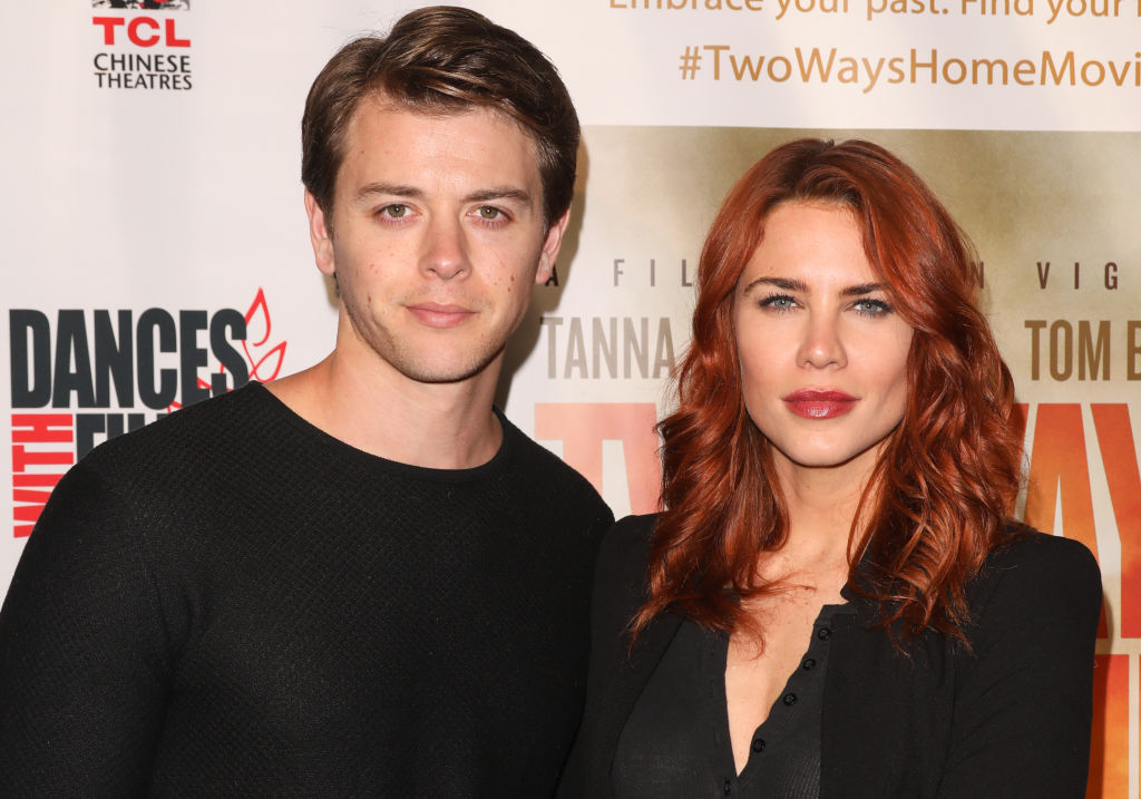 Chad Duell and Courtney Hope standing next to each other