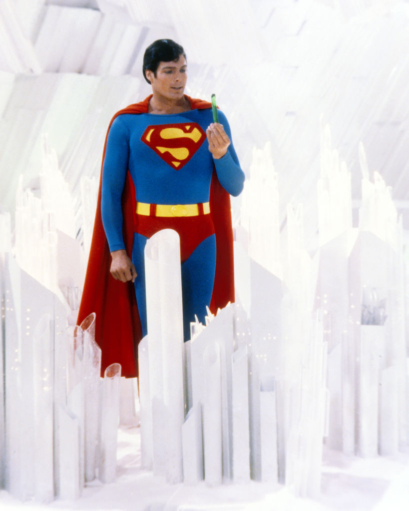 Superman, played by American actor Christopher Reeve (1952 - 2004), holds a green crystal at the Fortress of Solitude, in a promotional still from 'Superman' (1978)