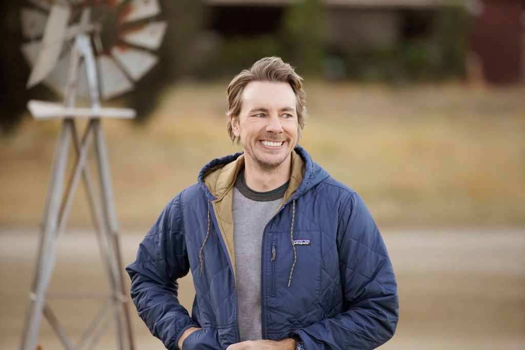 Dax Shepard simling on the set of 'Bless This Mess'