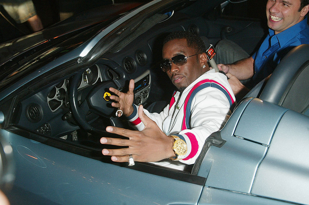 Diddy riding in a convertible